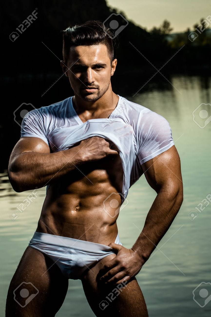 60441620-handsome-young-macho-man-with-muscular-sexy-body-and-six-packs-on-torso-in-pants-and-wet-shirt-sunny.jpg