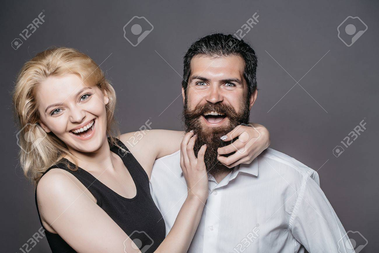 Young Couple Of Woman With Pretty Smiling Face And Blonde Hair