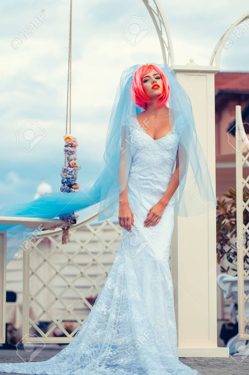 Young Woman With Orange Or Pink Hair And Bright Makeup On Pretty ...
