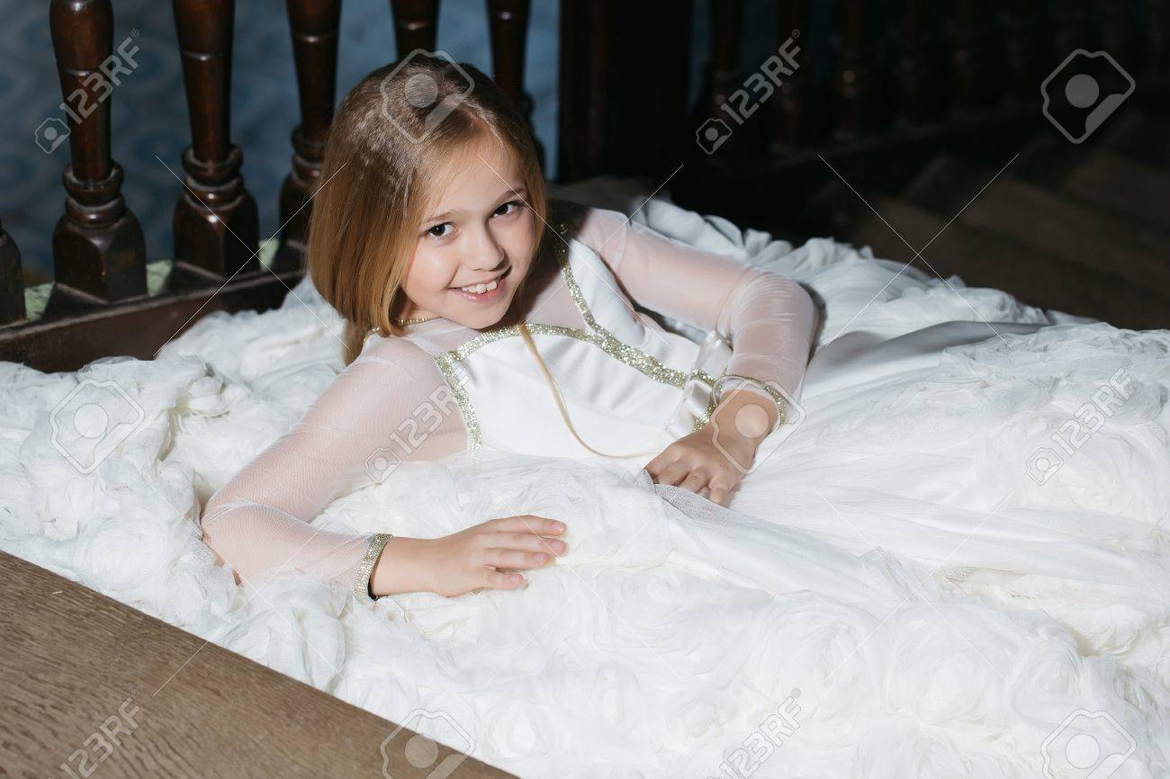 Small Girl Kid With Long Blonde Hair And Pretty Happy Smiling ...
