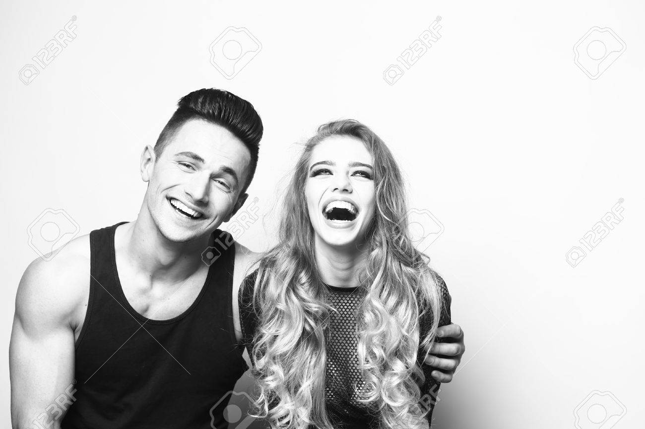 Stock photo young couple sitting in studio beauty and fashion friends black and white