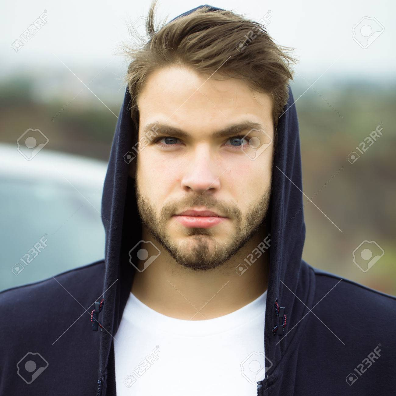 Young Man With Bearded Serious Face Brown Hair And Blue Eyes Stock