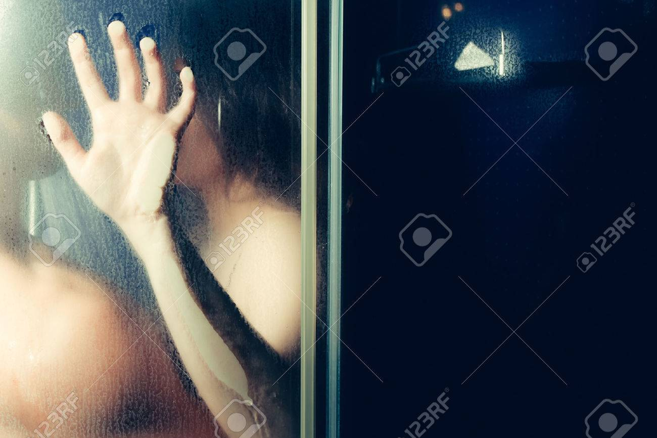Man and woman behind the glass in the shower - 62480691
