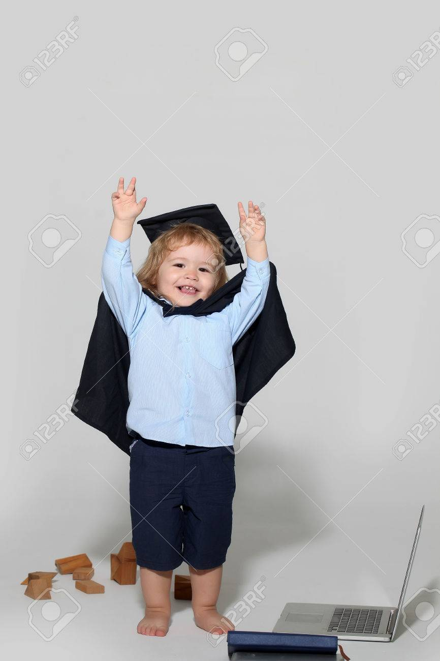 Small Boy Child With Long Blond Hair In Blue Shirt Black Graduation
