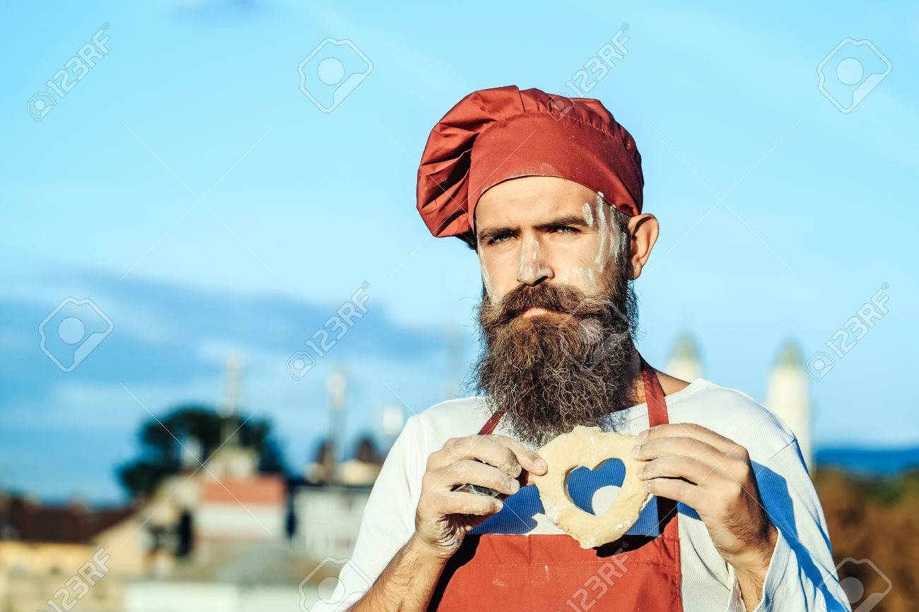 Handsome Bearded Man Cook Chef Uniform And Red Hat With Long Stock