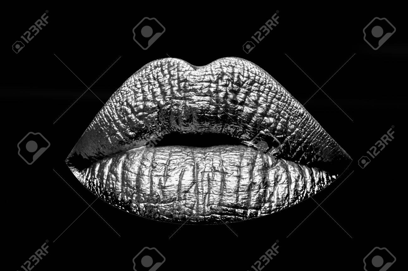 Sexy female silver or grey lips isolated on black background as makeup or body art painted