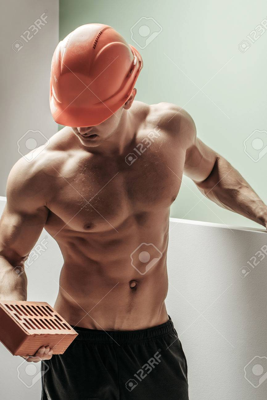 Stock Photo - young handsome macho man builder with sexy muscular athletic  strong body has bare torso and strong belly with six packs or abs in orange  hard ...