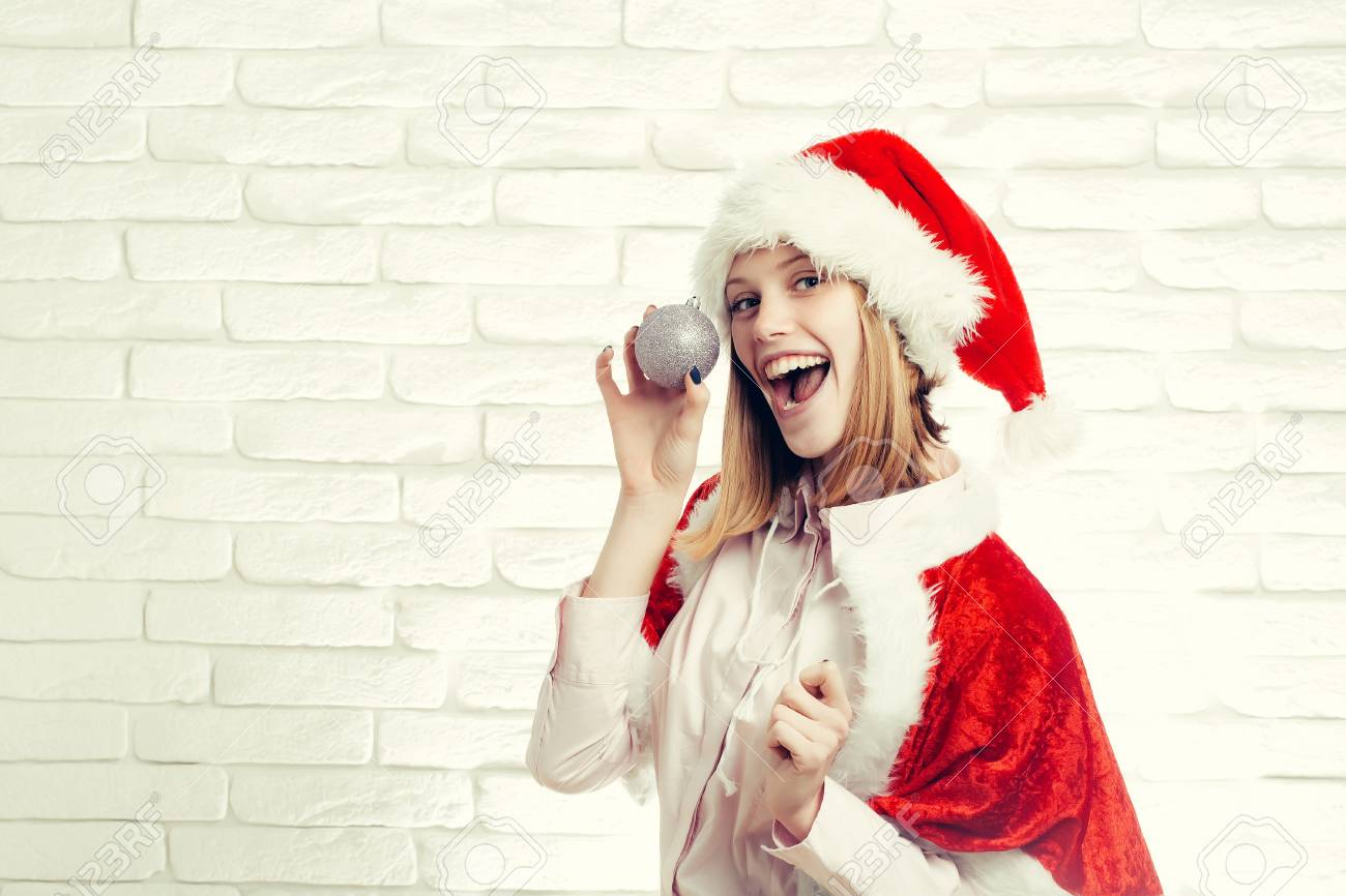 e860313bfb young sexy new year woman or cute smiling girl with pretty happy face in red  christmas santa claus holiday hat and coat holds silver decorative ball on  ...