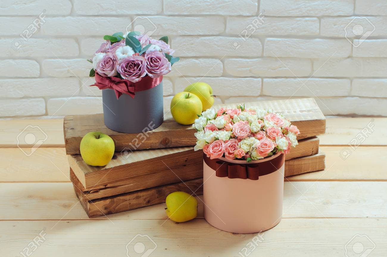 Beautiful rose flowers bouquet in boxes pink and violet colors beautiful rose flowers bouquet in boxes pink and violet colors near green apples on wooden planks izmirmasajfo