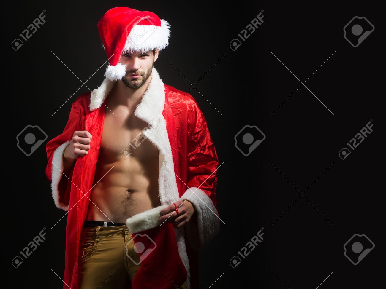 Christmas Model.Handsome Santa Claus Guy Sexy Young Bearded Macho Christmas Man