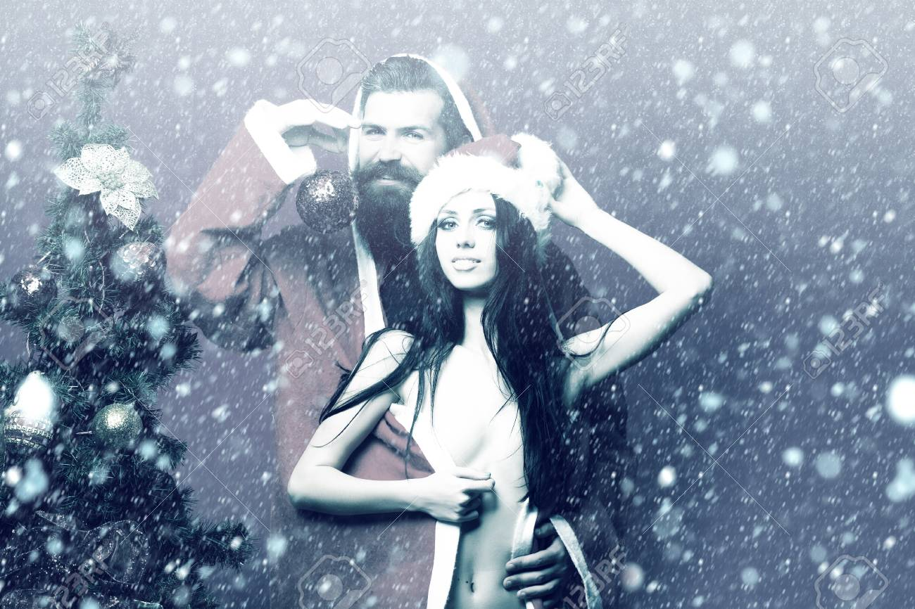cdee0da92754a bearded santa claus man with long beard in new year coat with pretty sexy  naked girl