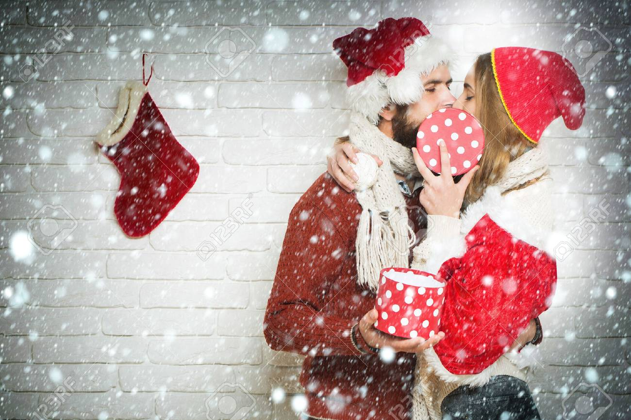 Young Kissing Christmas Or New Year Couple Of Bearded Man With ...