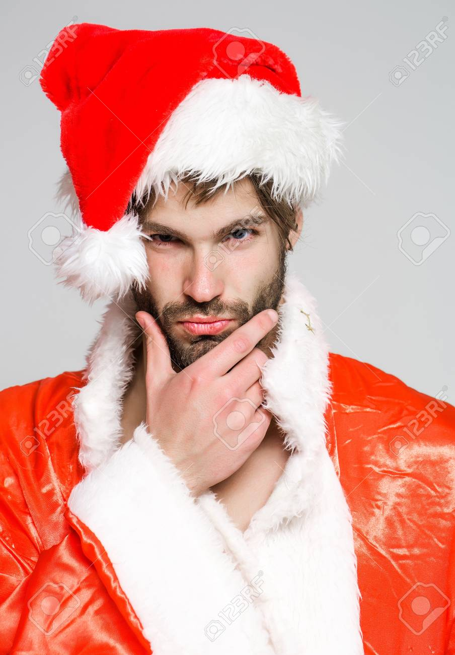 Christmas Facial.Handsome Sexy Bearded Christmas Man With Beard On Serious Face