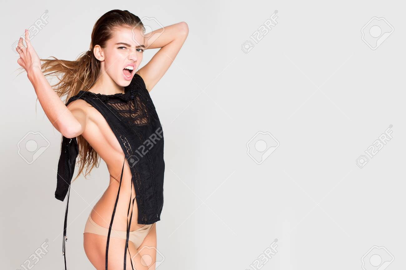 Stock Photo Young Pretty Hot Woman Or Cute Sexy Passionate Girl With Long Wet Hair In Fashionable Black Lace Bodysuit And Panties Poses On White