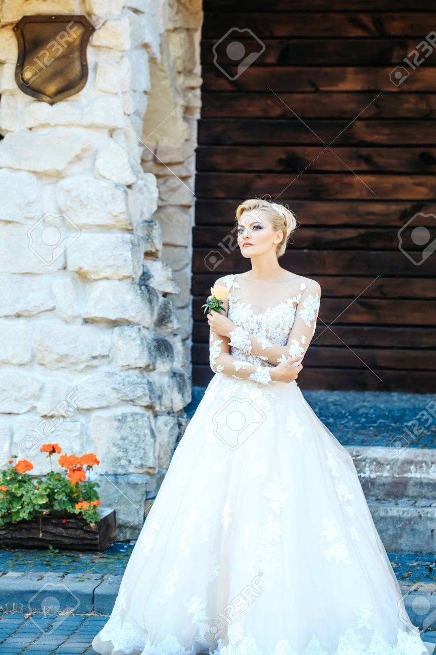 Pretty Girl Or Beautiful Bride In White Wedding Dress With Flower On Sunny Summer Day Outdoors: Beautiful Stone Wedding Dress At Websimilar.org