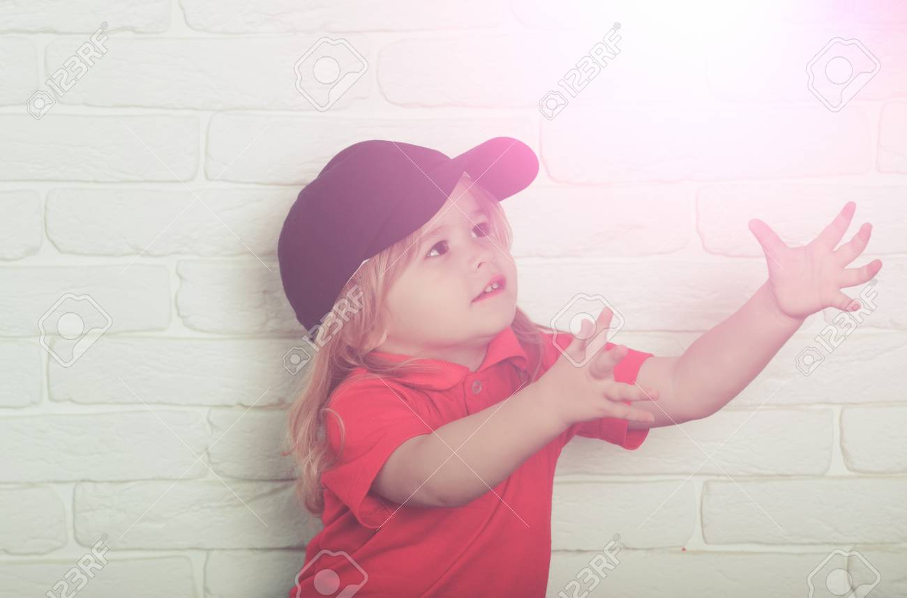 54886a0452f72 cute happy little boy with long blonde hair in fashionable blue cap and red  shirt with