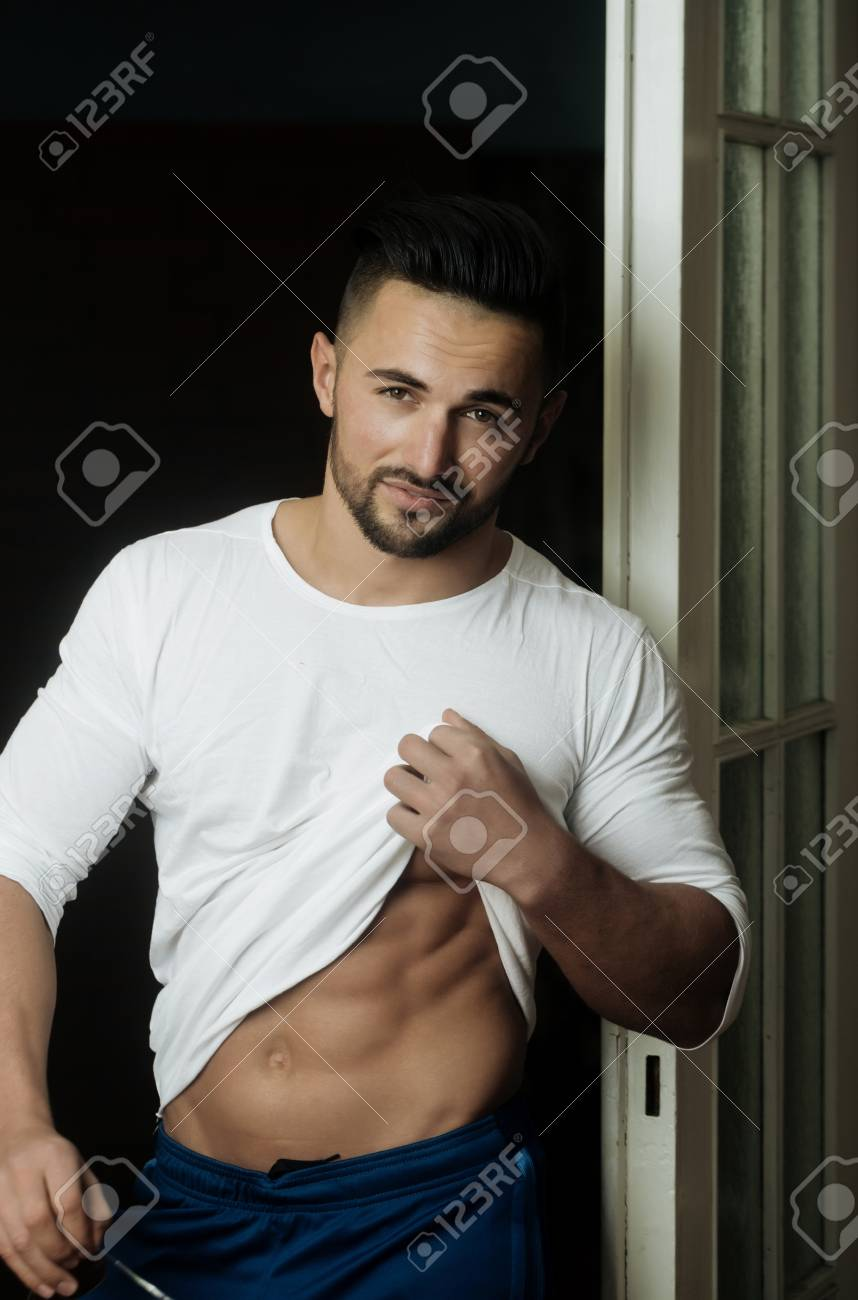 Handsome man sexy macho or young model with stylish hair and beard showing muscular belly  sc 1 st  123RF.com & Handsome Man Sexy Macho Or Young Model With Stylish Hair And ...