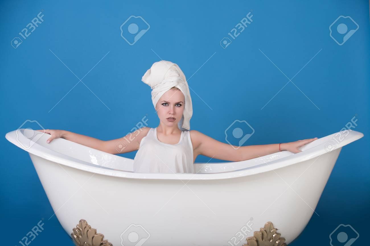 Woman In Bath. Girl With Towel Turban On Head Sitting In White ...