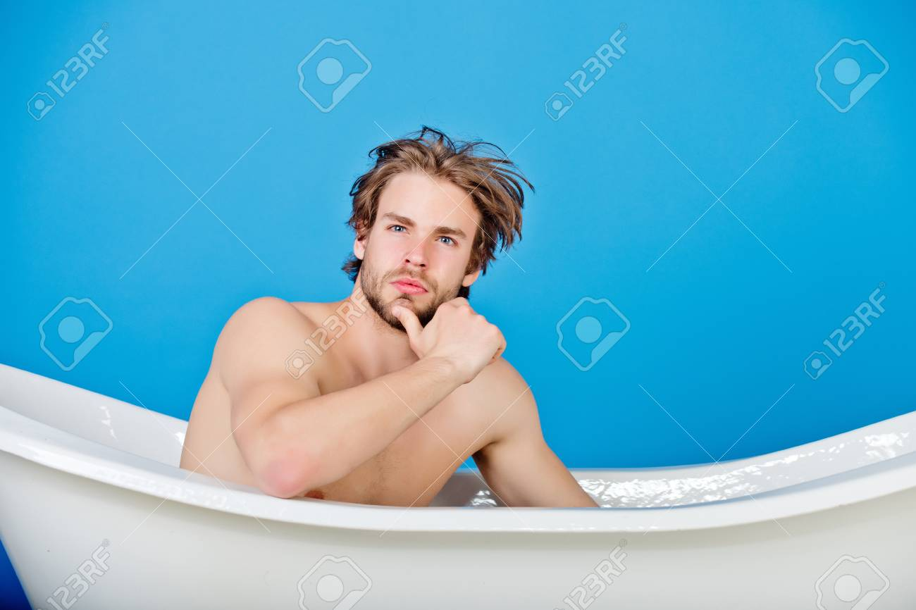Guy With Muscular Body And Bare Chest Has Fashion Hair Sitting ...
