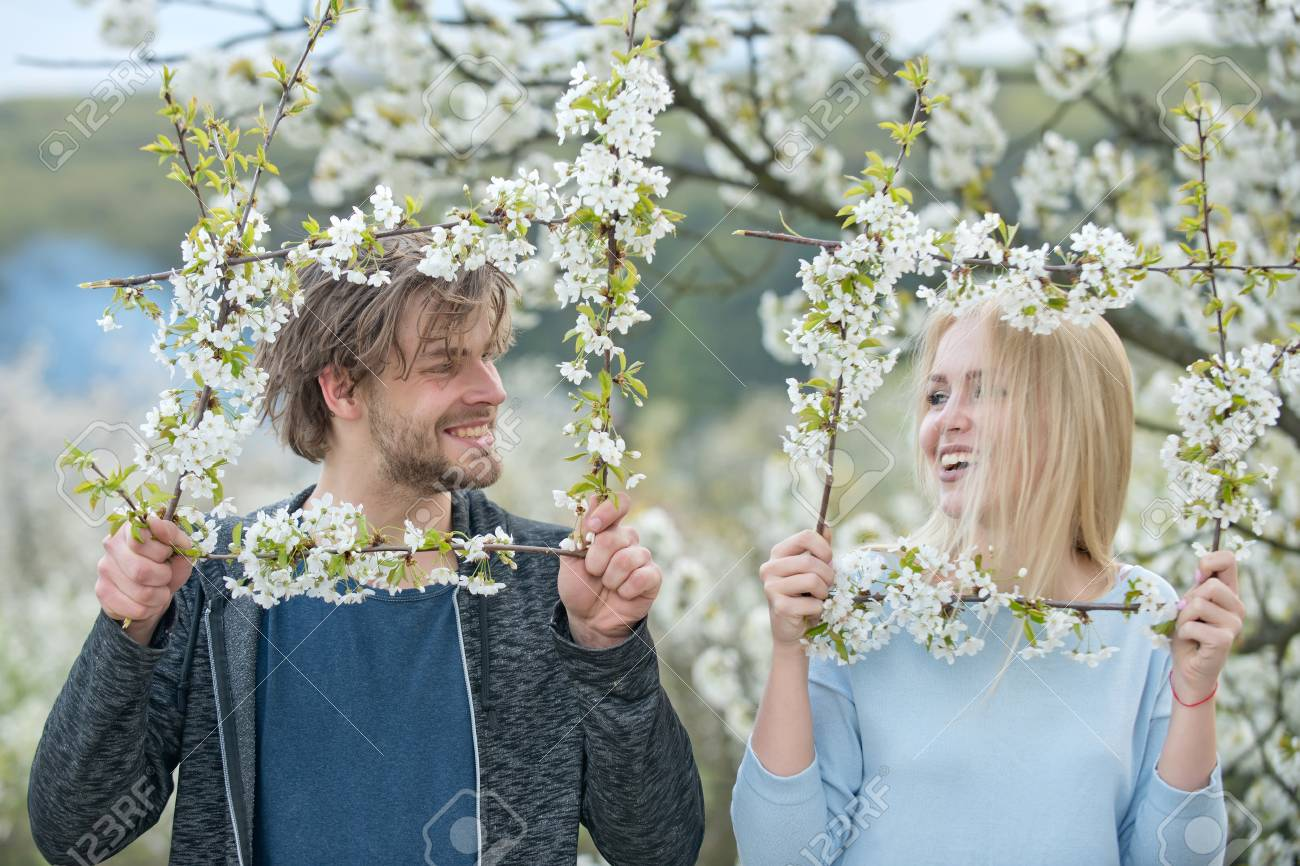 Man And Woman In Spring. Couple In Love In Blossoming Flower ...
