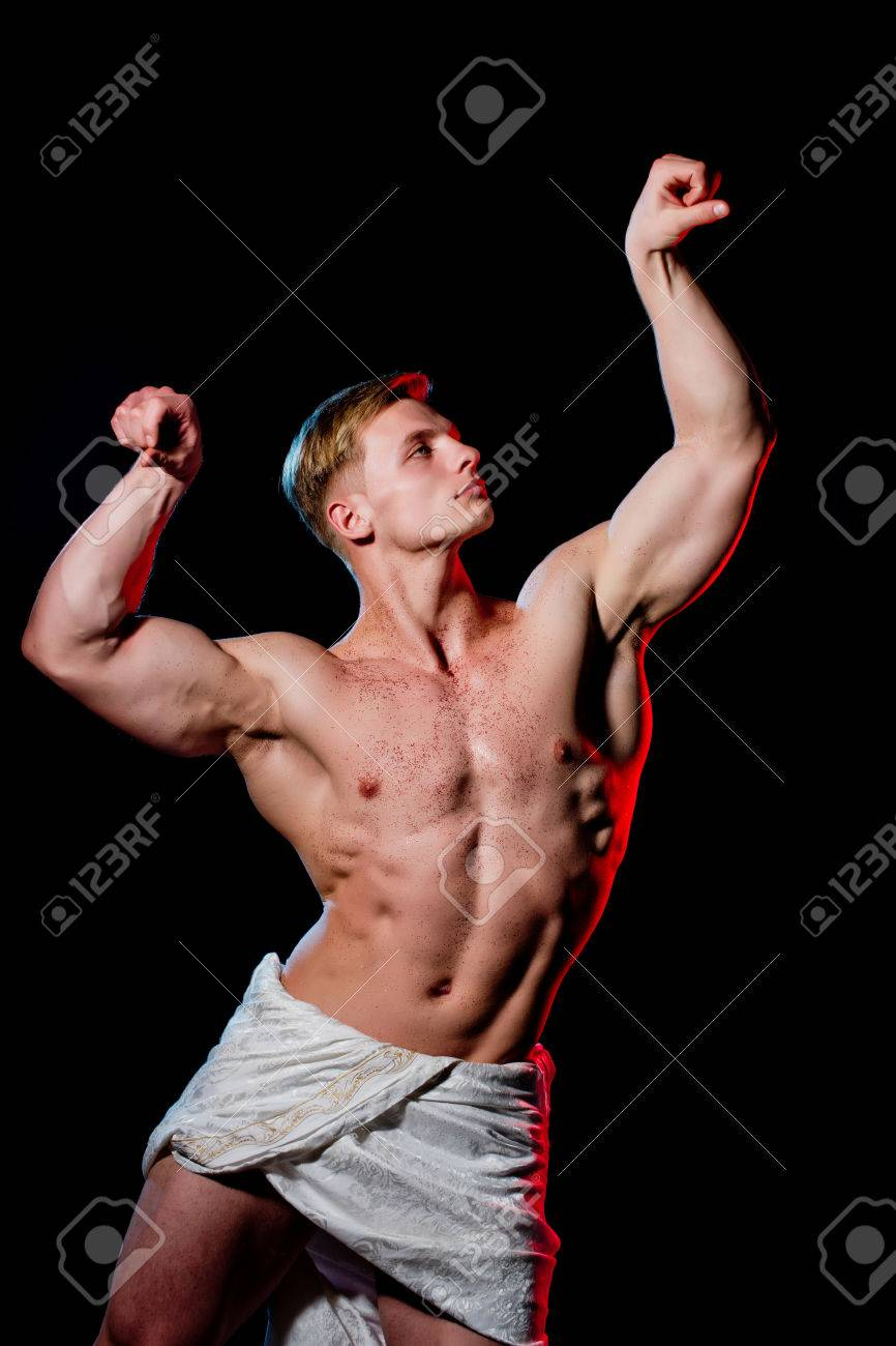 9f4c5b079 Gladiator or greek god. Athletic bodybuilder pose as statue. Man with  muscular wet body