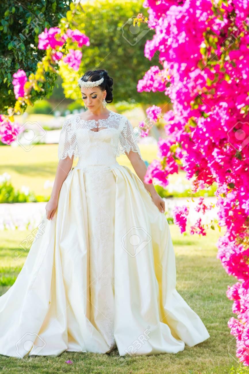 Girl Bride In Wedding Dress Posing At Meadow. Wedding Dress Jewelry ...
