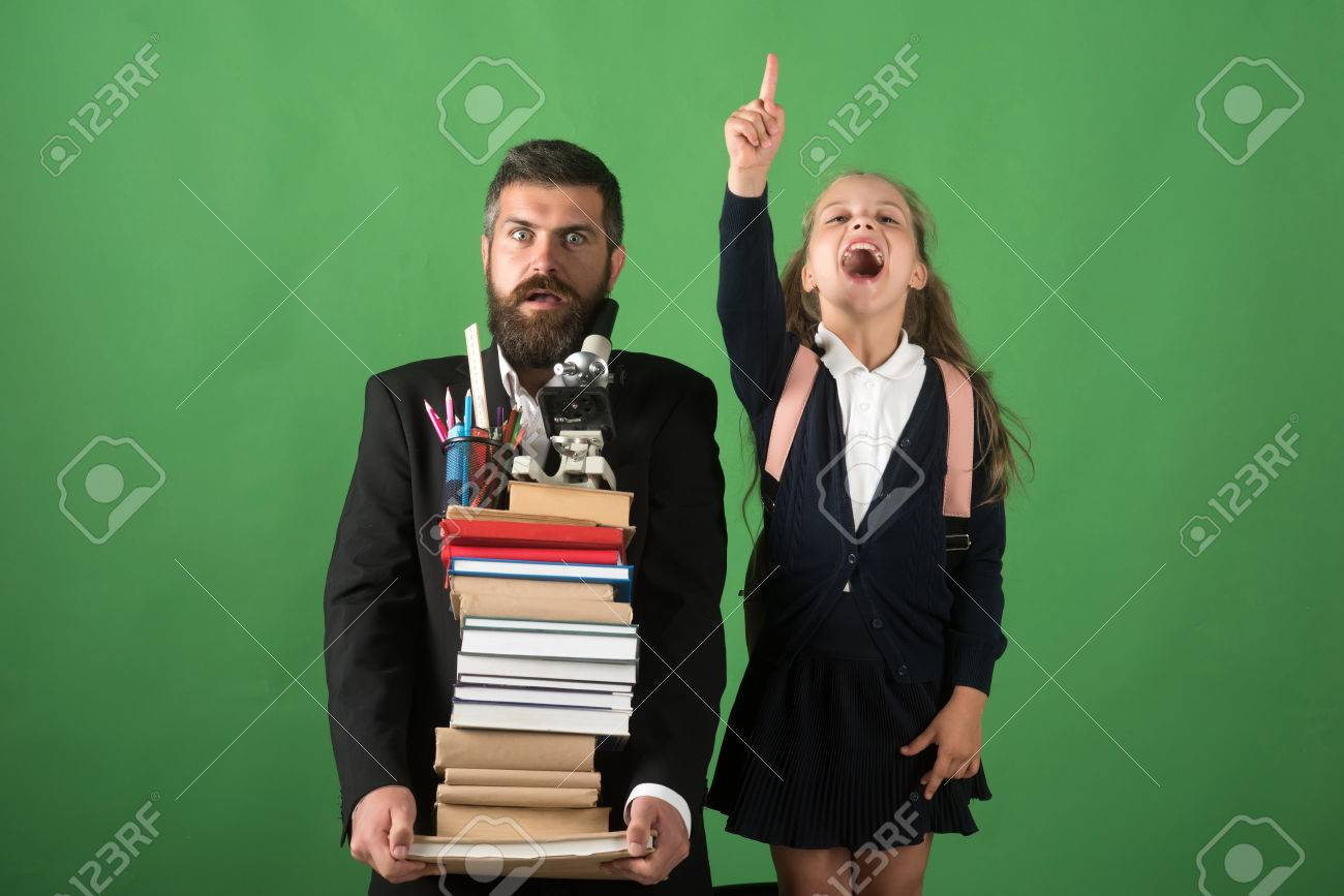 Stock Photo Teacher And Schoolgirl With Scared And Enthusiastic Faces On Green Background Kid And Tutor Hold Books Stationery And Microscope