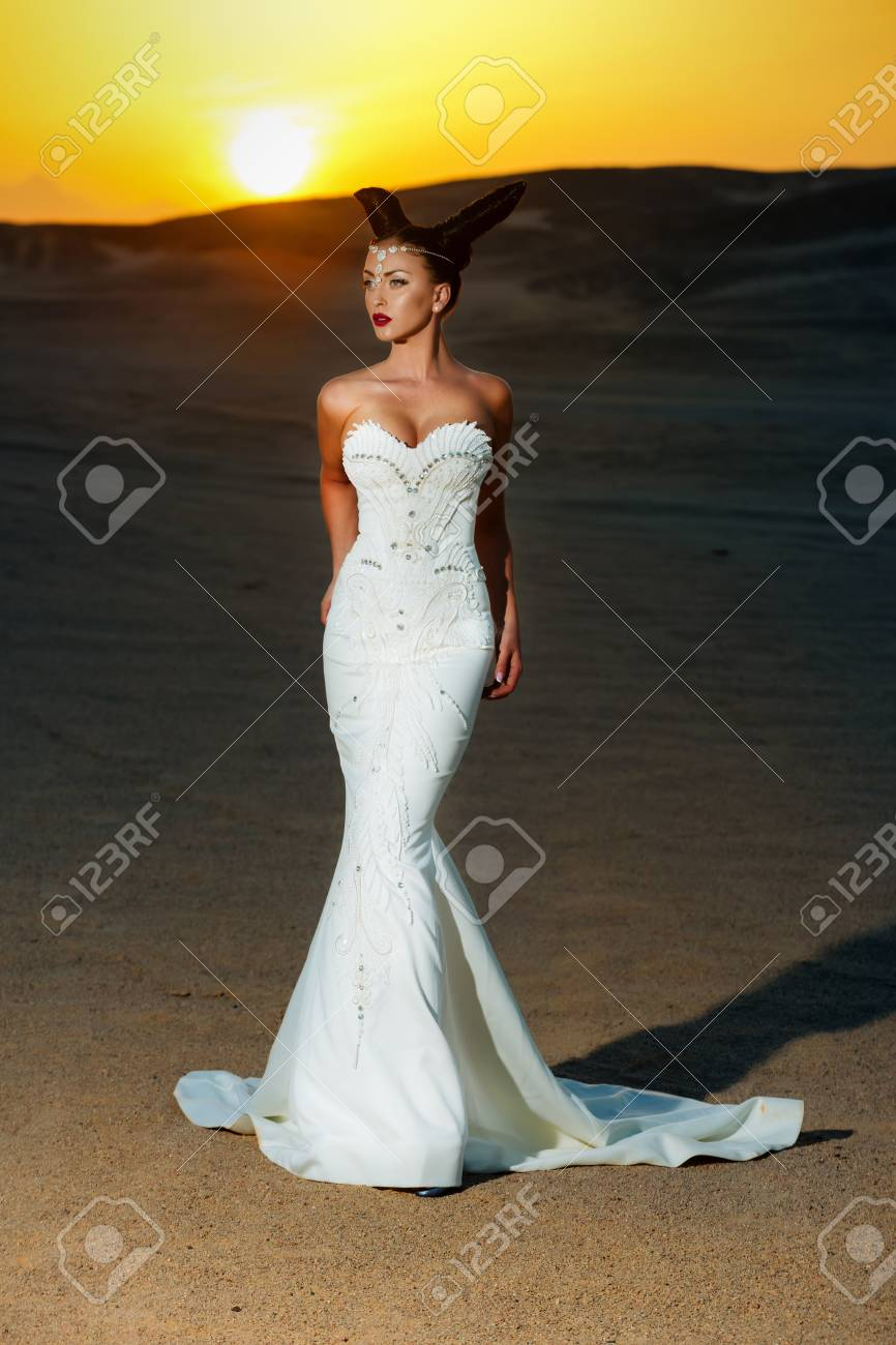 Woman Posing On Yellow Sunset Girl In White Wedding Dress In
