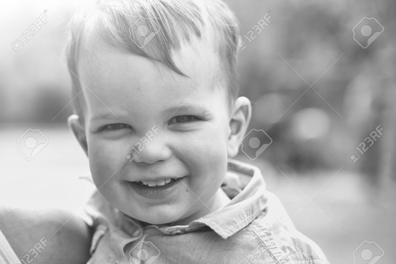 1a16e4430080 Cute happy baby boy, little child, with blond hair in blue shirt smiling on