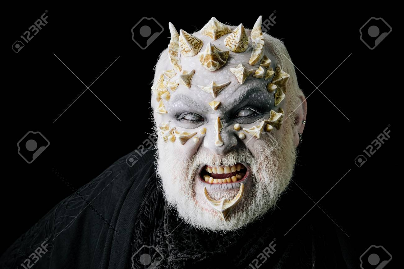 Evil face with dragon skin and grey beard  Man angry with blind