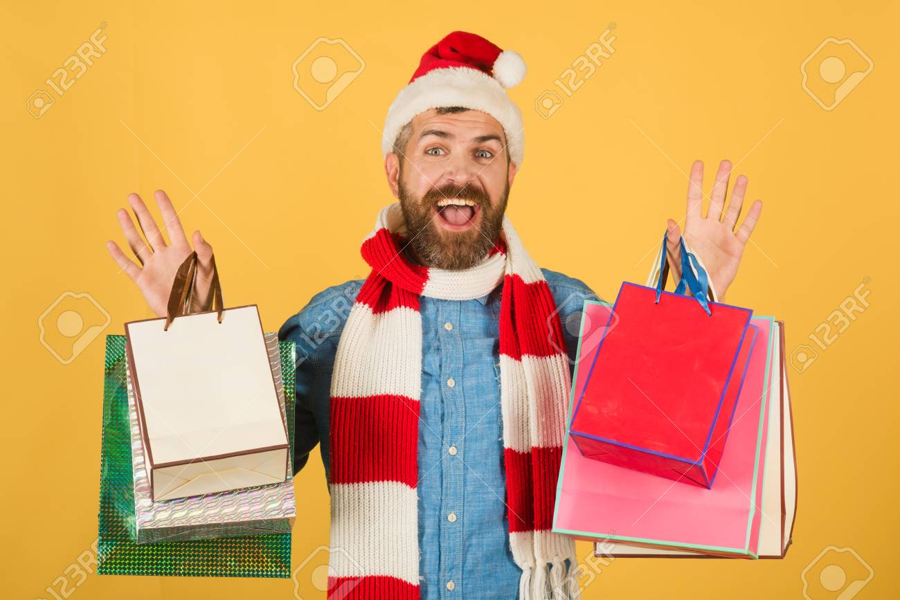 4f6ac8084c39f Christmas sale black friday concept. Hipster shopper smile in santa hat and  scarf. New