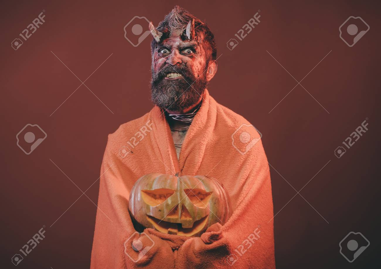 Halloween demon scary in blanket with jack o lantern  Satan with