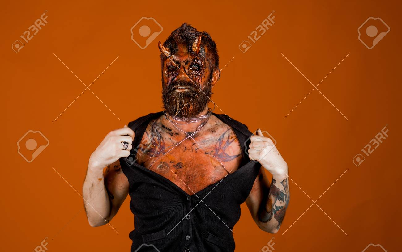 Halloween demon with bloody horns on head  Aggression, evil,