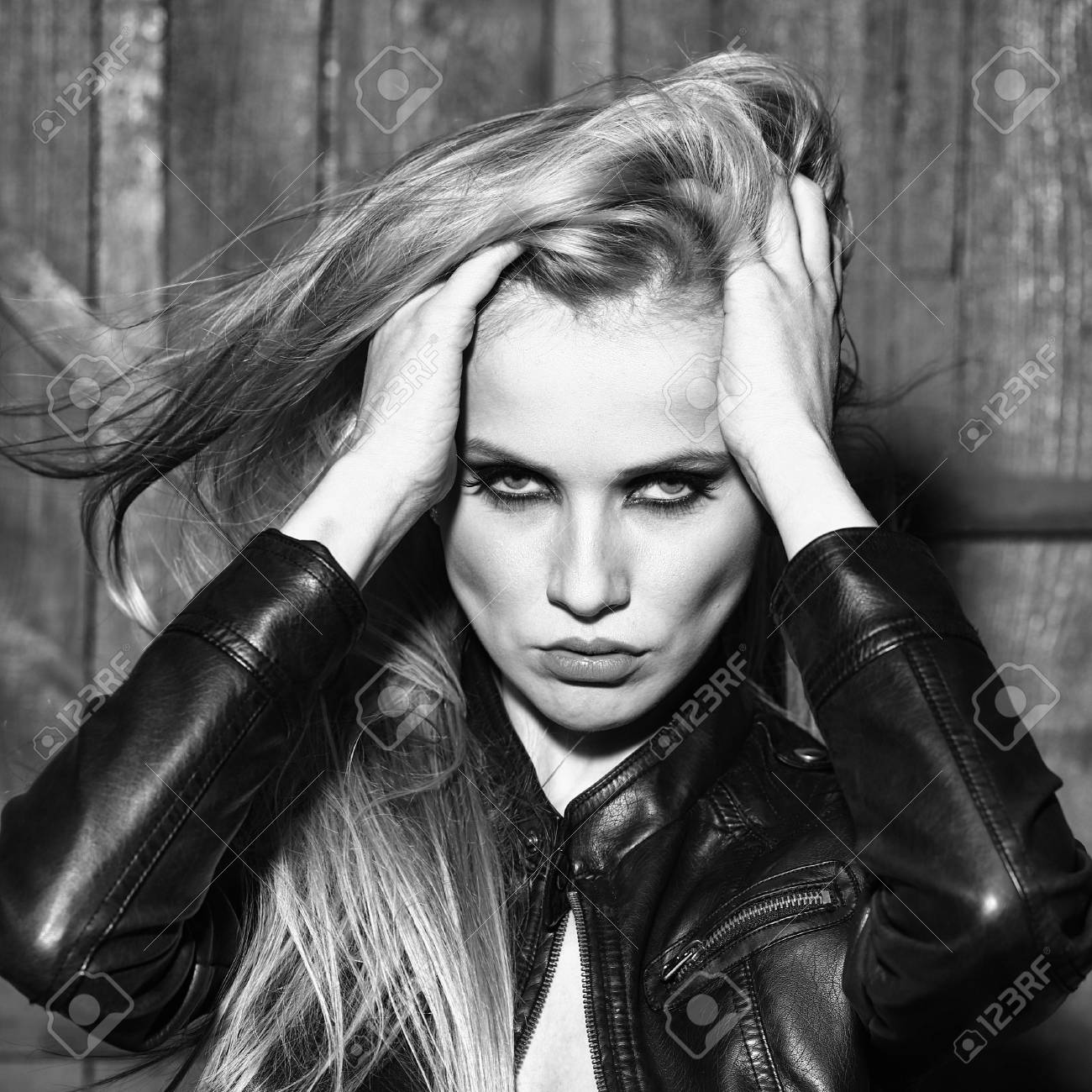 Portrait Of One Attractive Sensual Sexy Young Serious Passionate Blonde Woman Touching Long Hair With Hands