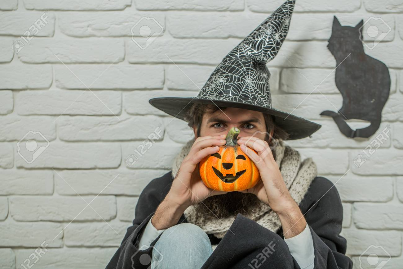 Halloween Maan.Halloween Man In Witch Hat Sitting On Floor Autumn Holidays