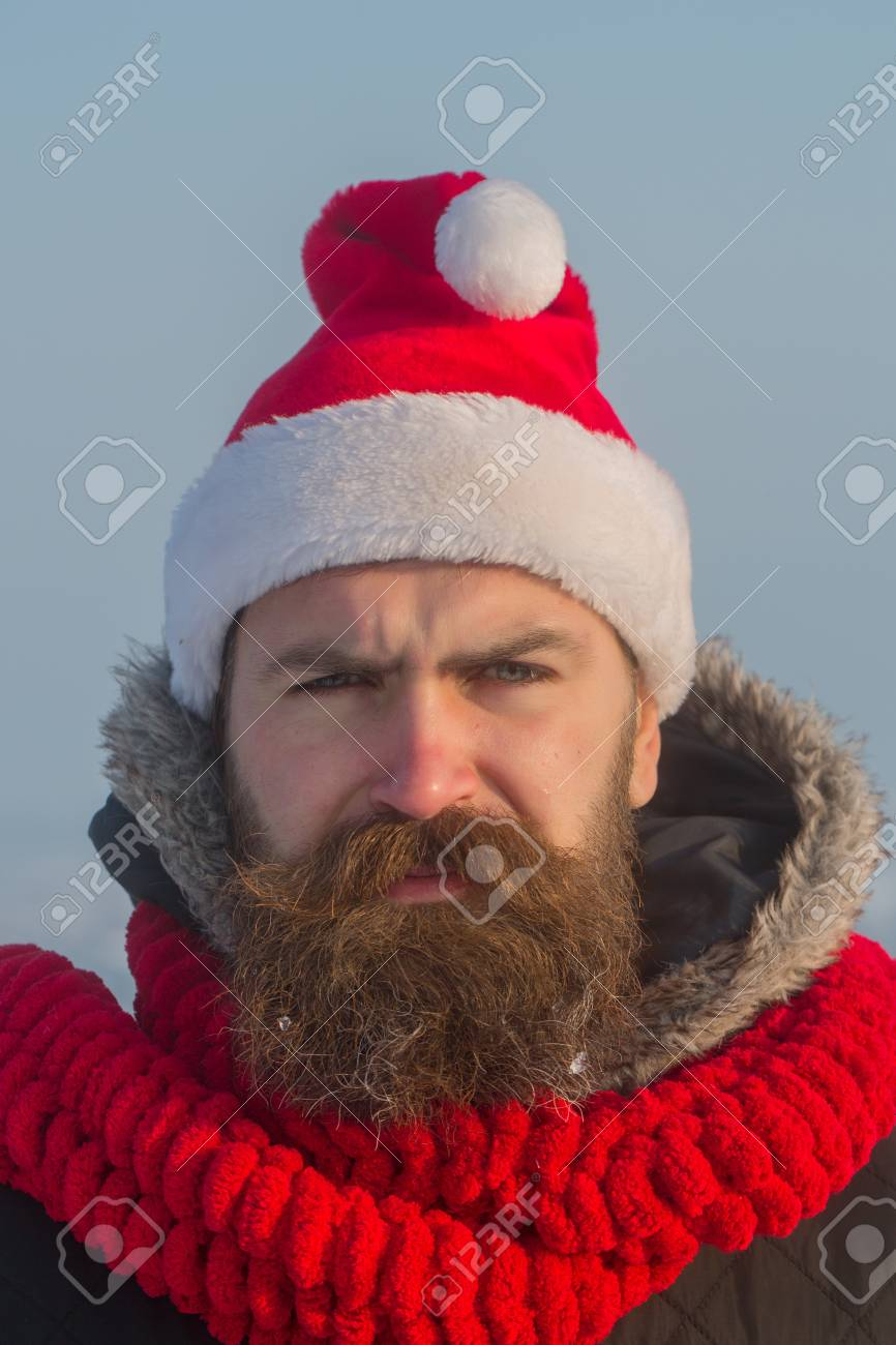 21d751006a1 Xmas party celebration. Santa claus hipster in red hat and scarf. Winter  happy holiday and vacation. New year guy on blue sky. Christmas man with