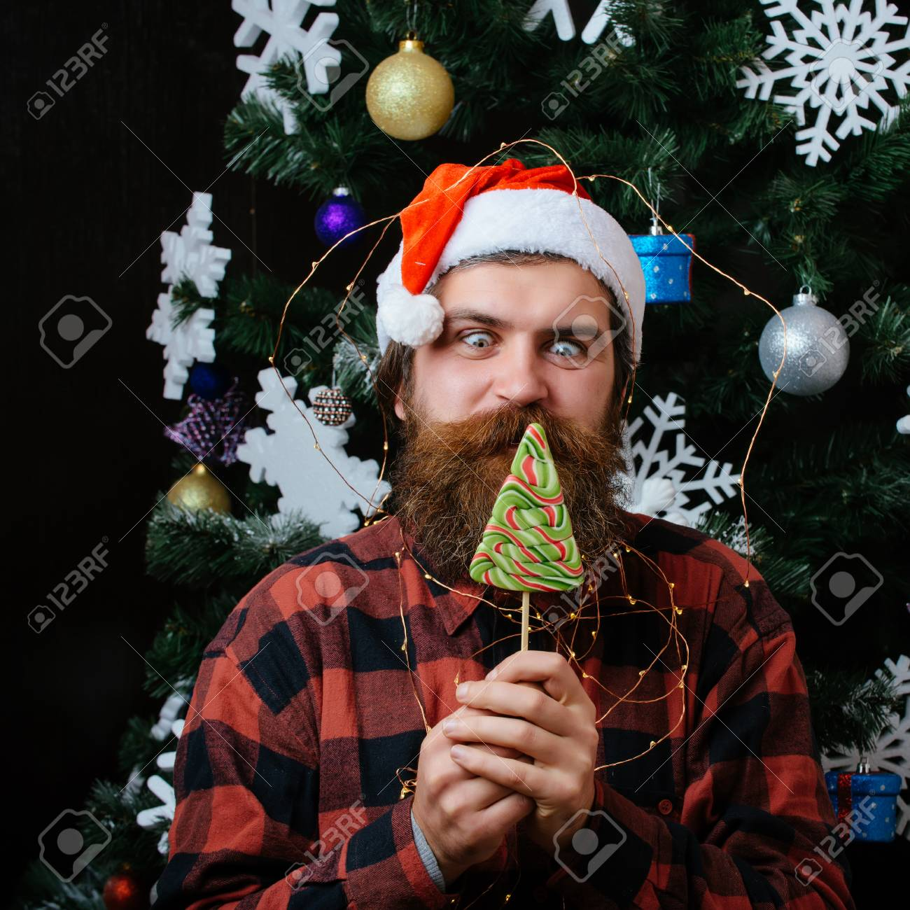 Christmas Beard.Party Celebration And Blowjob Santa Claus Man In Hat At Decoration