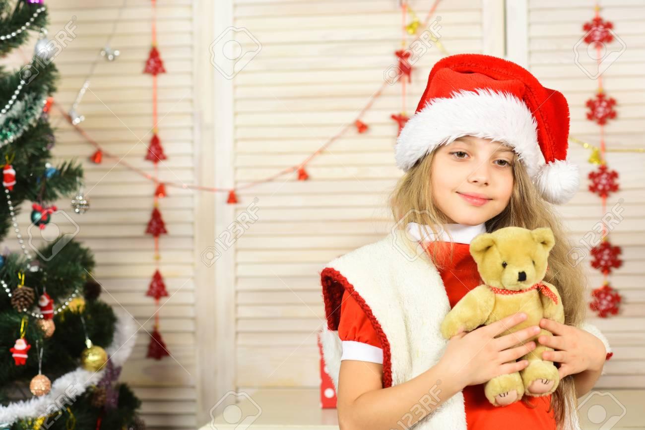 Santa Claus Kid At Christmas Tree. Winter Holiday And Boxing.. Stock ...