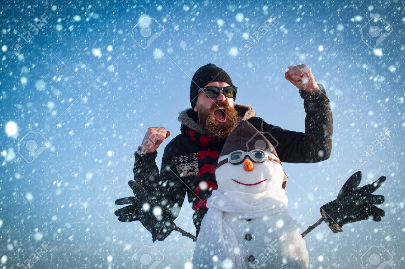 christmas new year snow concept New year guy at winter season. Snowman pilot, winter holiday celebration. Christmas man with beard on happy face. Santa claus man with snowman in hat. xmas - 90501851