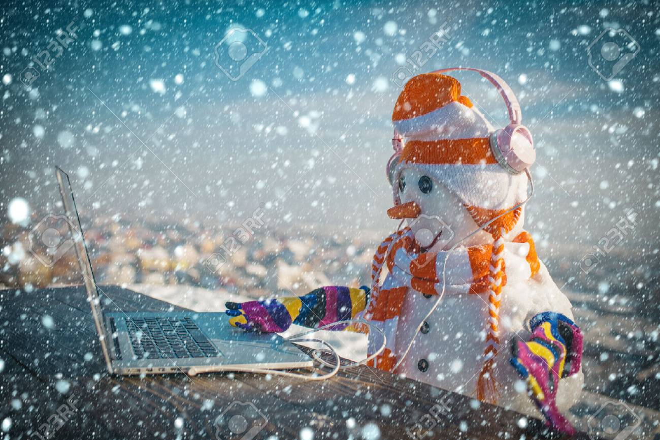 Snowman in winter with laptop, headset and tea cup. - 90502081