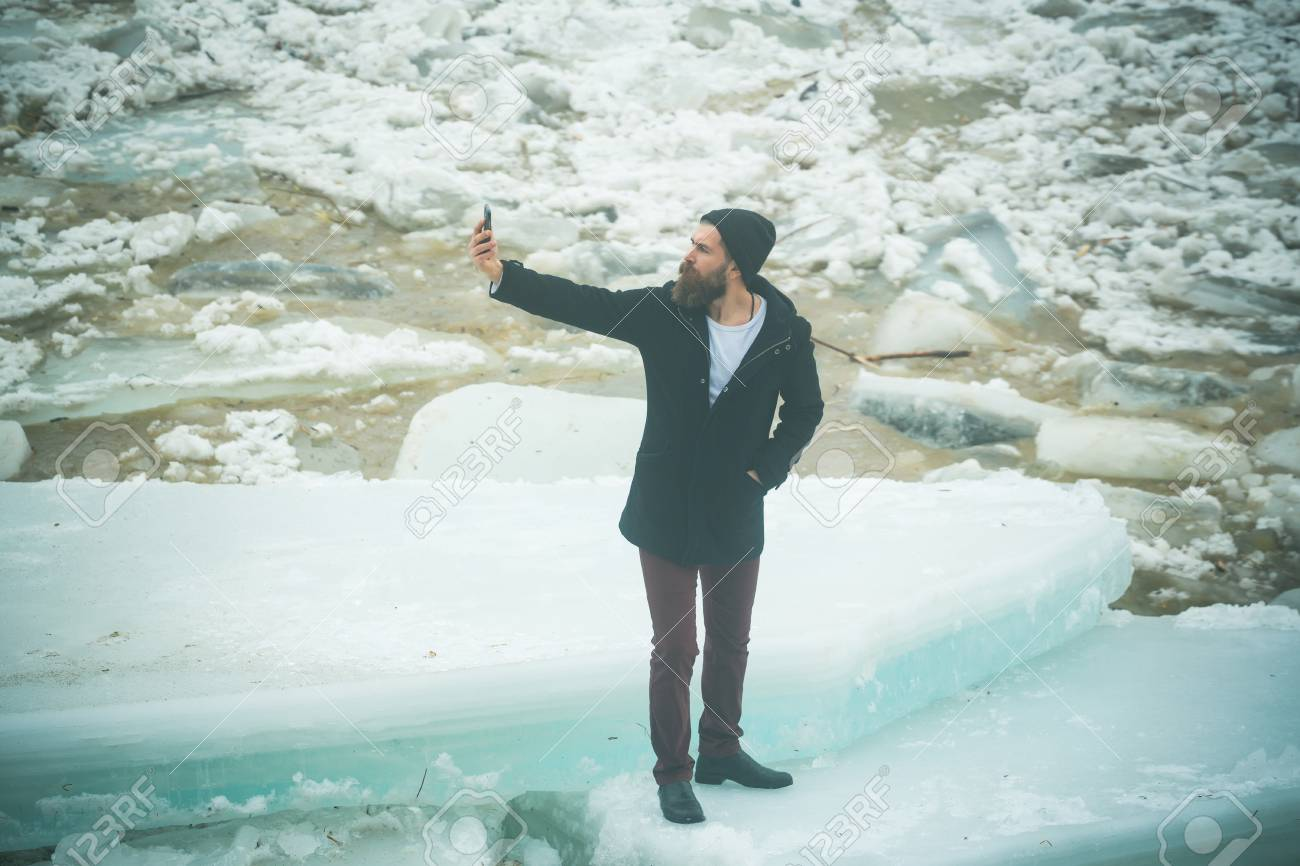 Winter Holiday And New Technology. Cracked Ice Background And ...