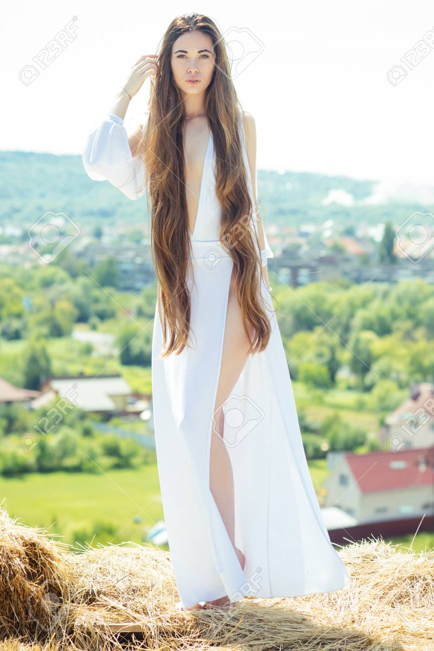 Girl In Sexy Dress Pose On Natural Landscape Woman With Long Stock Photo Picture And Royalty Free Image Image 92125340