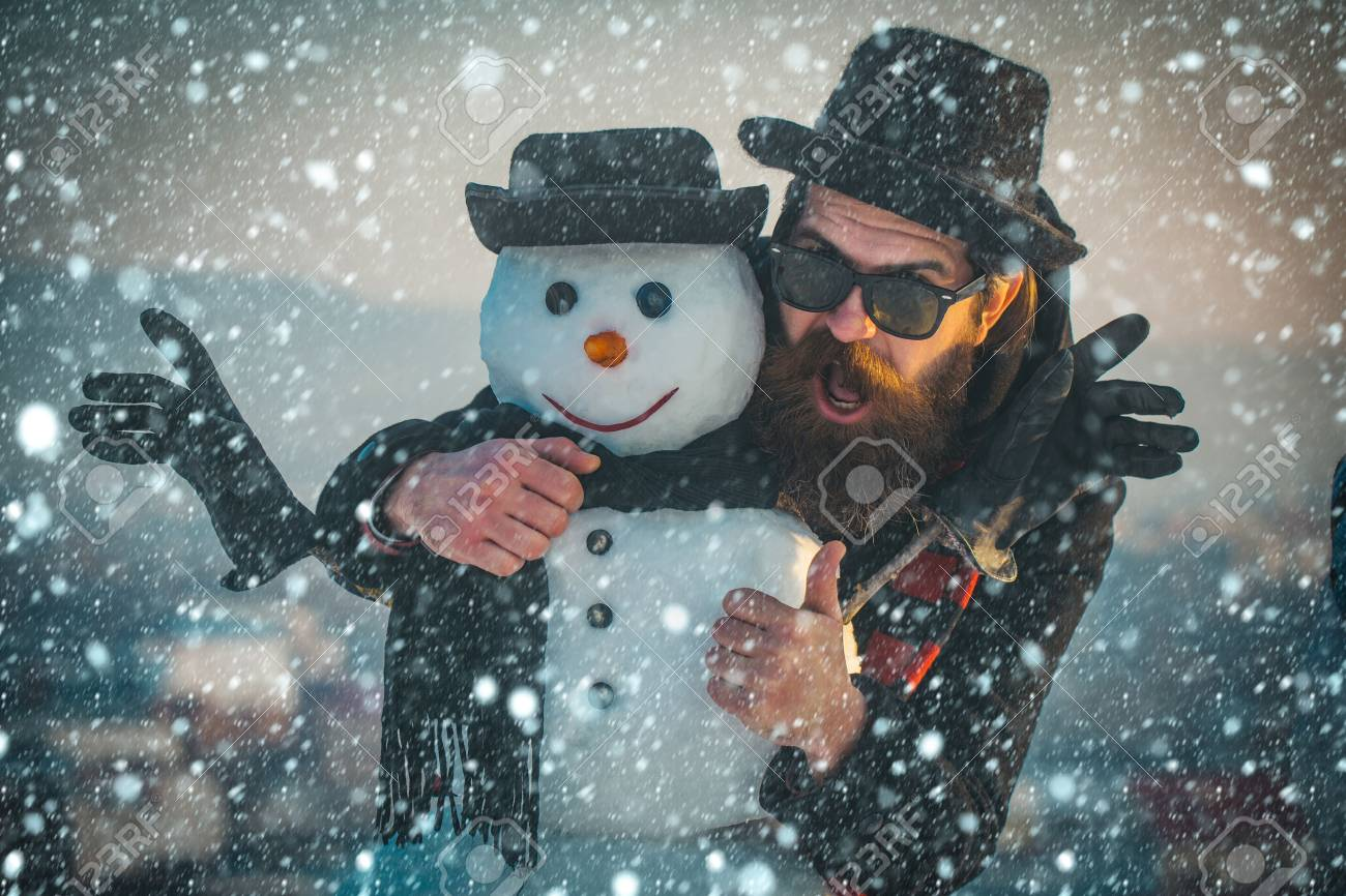 new year christmas snow concept Christmas man with beard on happy face. xmas leisure and winter season. Santa claus man with snowman in black hat. Snowman, winter holiday celebration. New year guy - 91862561