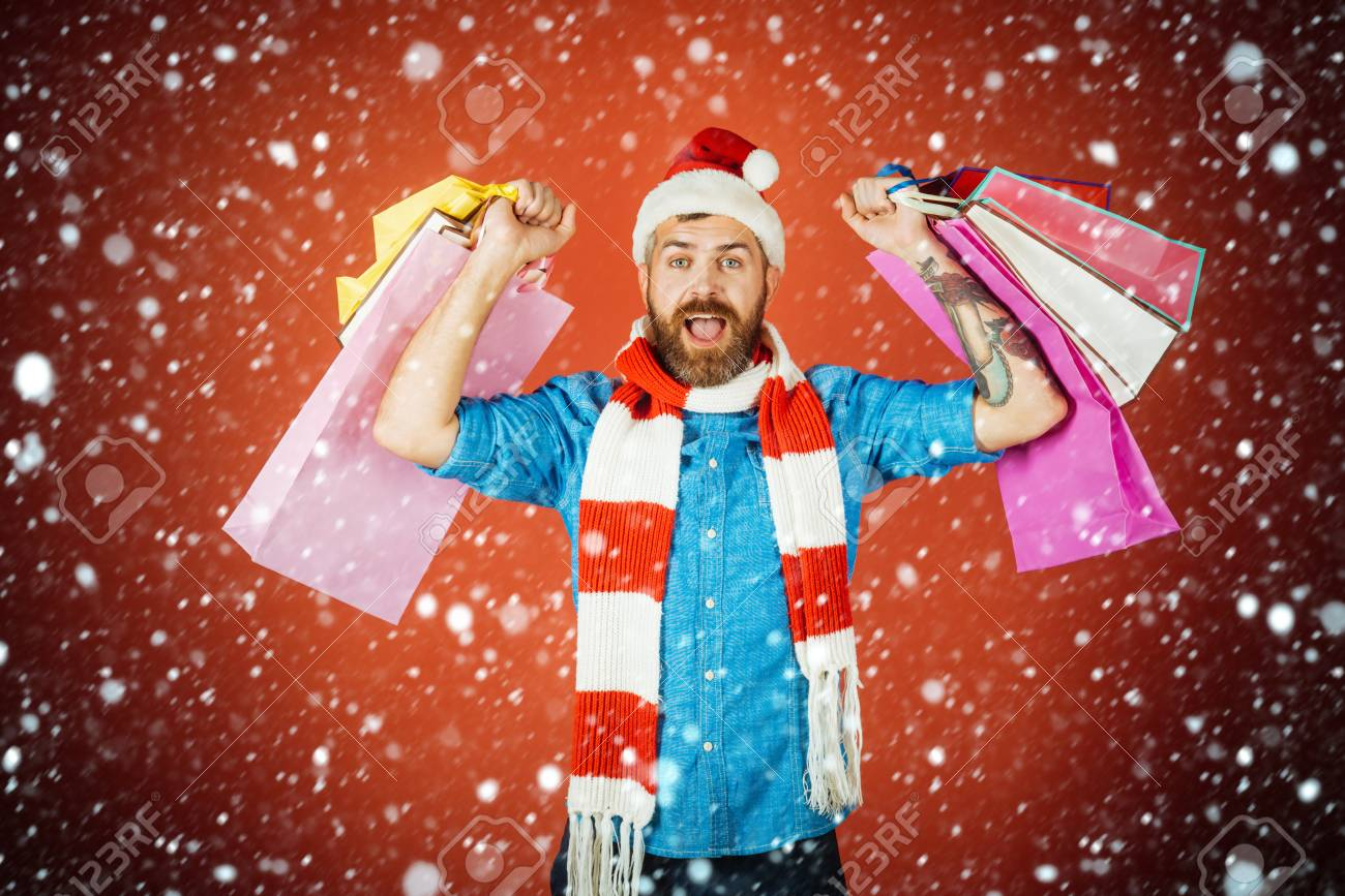 622196822 Christmas and new year snow concept Christmas man shopper happy..