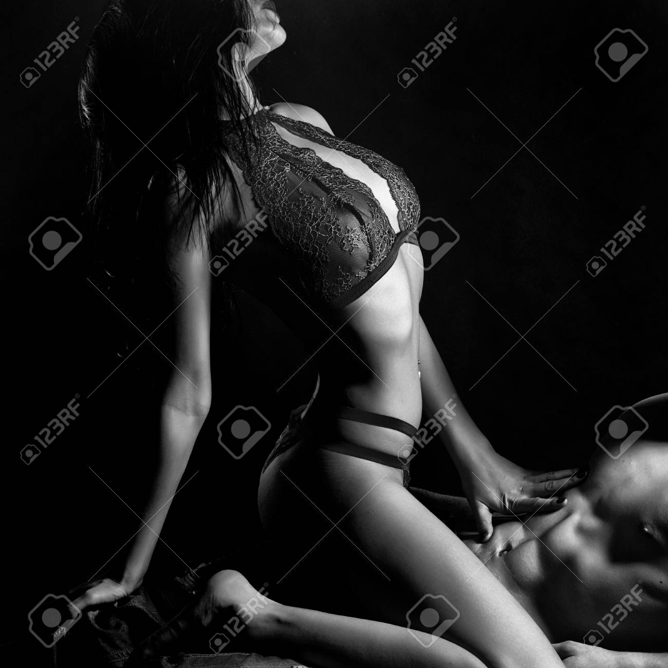 Sexy Young Couple Of Undressed Sensual Woman With Straight Body In Red Lace Erotic Lingerie Sitting