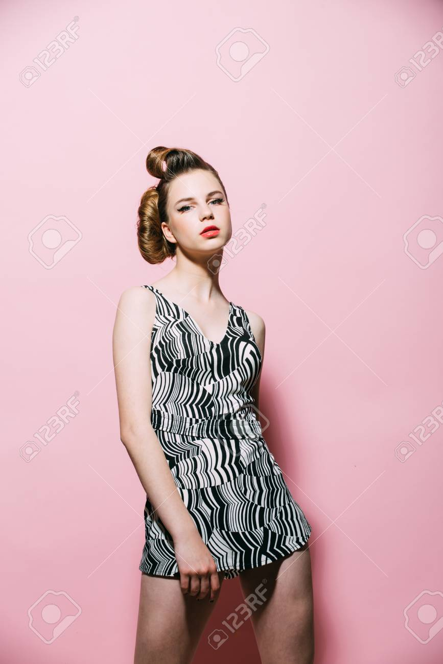 a6abd1b4f0a83 Girl in stylish vintage dress on pink background. Makeup, hairdresser and  cosmetics. Beauty and fashion, cosmetics. pinup, youth and look.