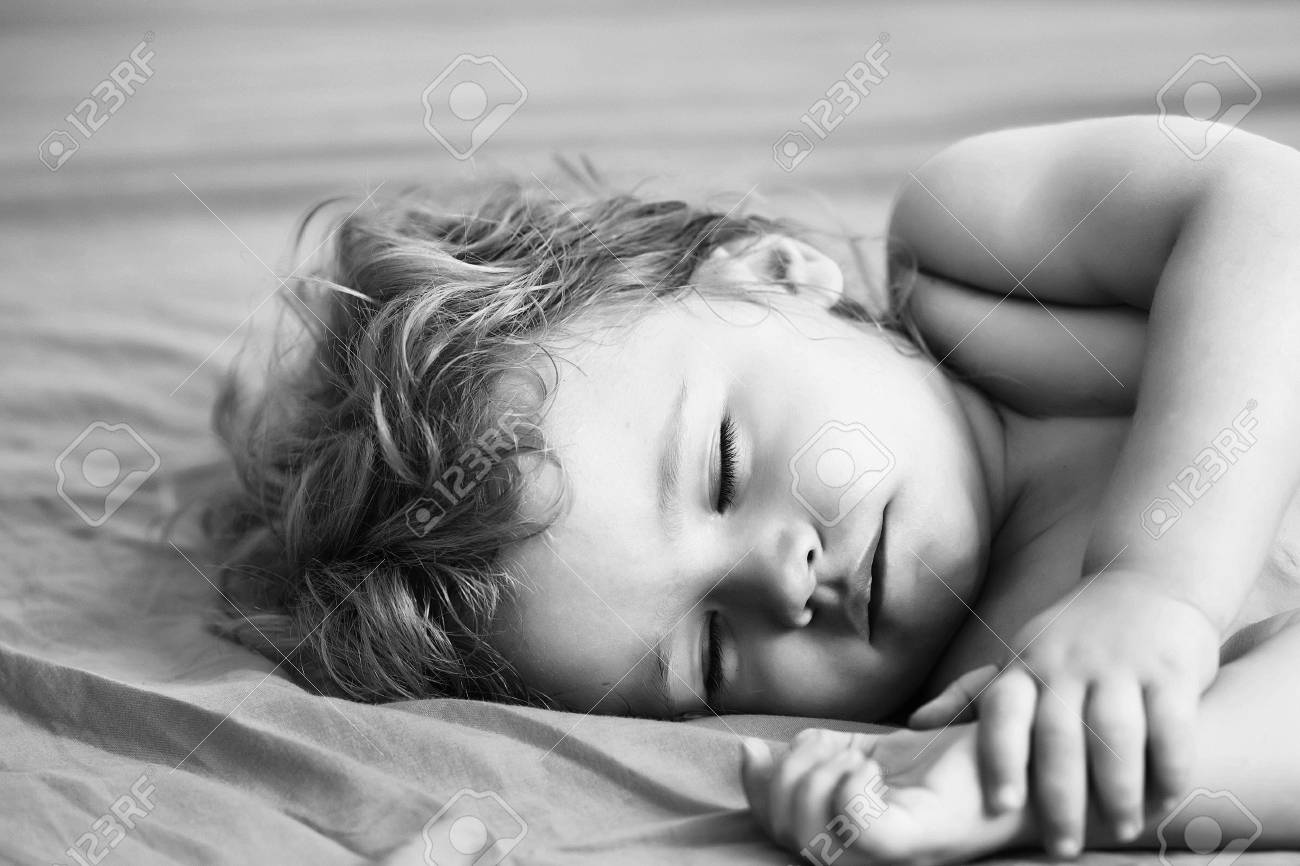 Cute Baby Boy Child With Blond Curly Hair Sleeps Peacefully With Stock Photo Picture And Royalty Free Image Image 93436204