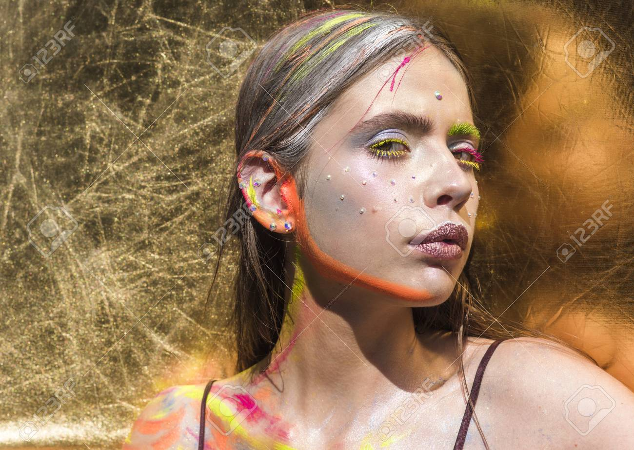 Indian woman with colorful neon paint makeup face. Indian woman with visage, make up