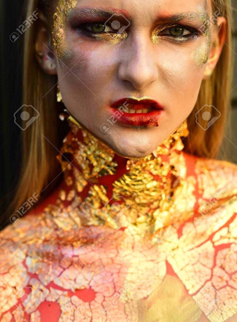 Halloween Vampire Zombie Woman With Cracked Skin And Makeup Eyes