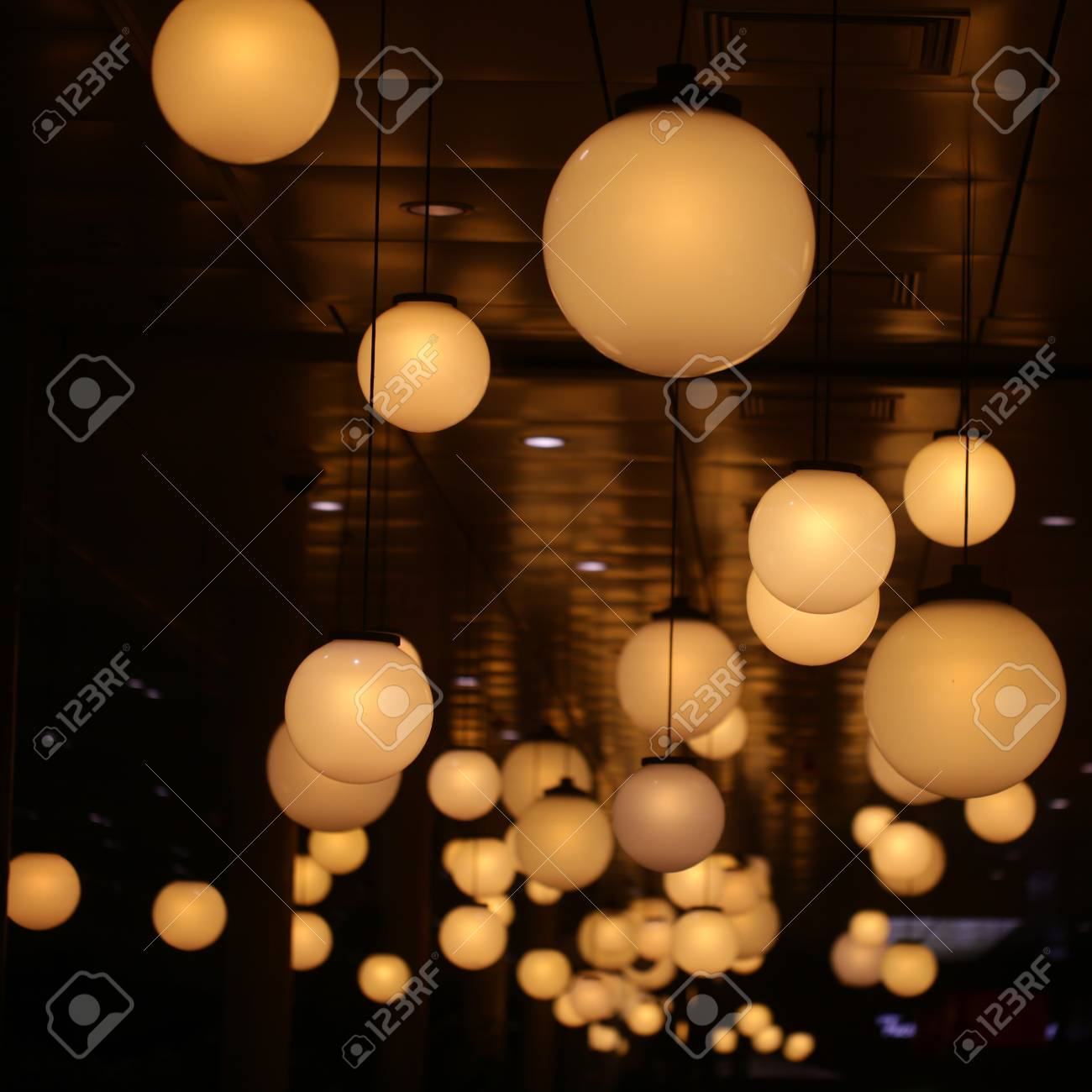 Ceiling lights of spherical shape on dark background lighting